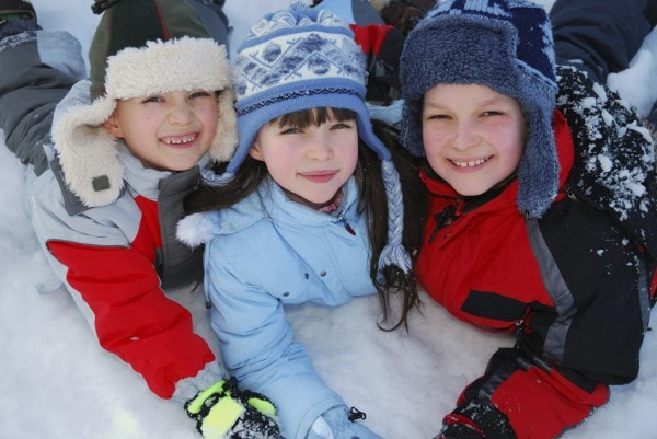 Kids in coats thanks to your dentist in Alexandria