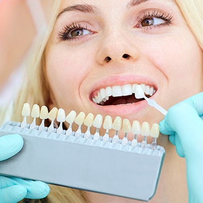 A blonde lady getting teeth whitening