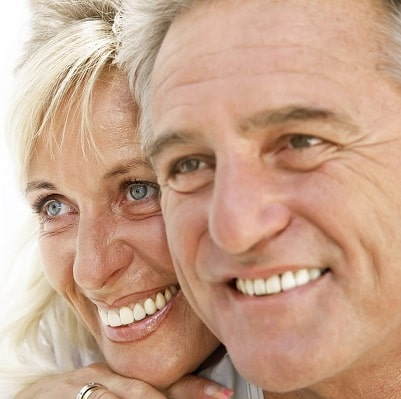 Full head shots of smiling man and woman.